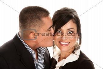 Hispanic man kissing pretty woman