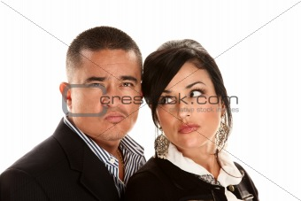 Skeptical or angry Hispanic couple