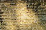 Brick wall lighted sun beams