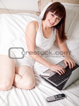 Attractive working woman winding down