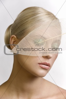 closed eyes portrait with leaf