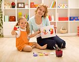 Girls having fun painting hands