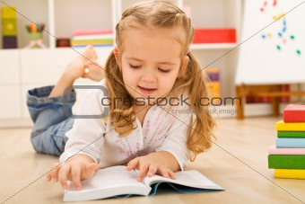 One day I will read all this - little girl with books