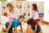 Kids playing with friends in their room
