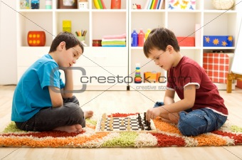 Let me show you a move - kids playing chess