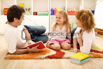 Story time - happy family with a child