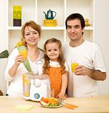 Healthy family drinking juice made from fresh fruits