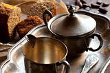 Silver utensil, bread and cocoa