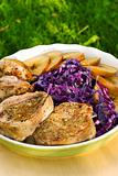 Pork medallions with apples and cabbage