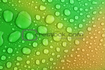 Green water drops background with big and small drops