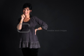 beautiful pregnant woman on black background