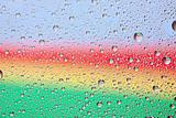 Rainbow water texture on a glass