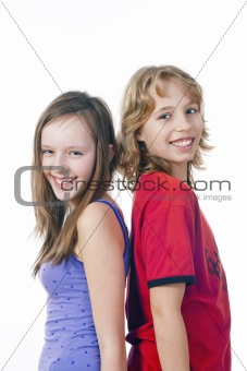 boy and girl standing next to each other smiling - isolated on white