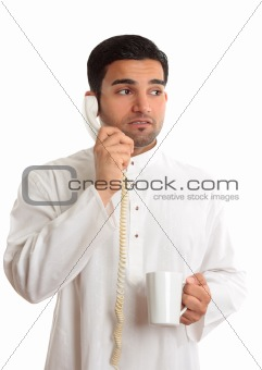 Business dilemma - worried man on phone