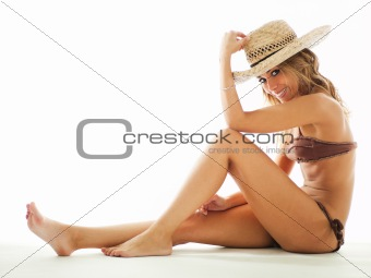 blond woman in bikini and straw hat