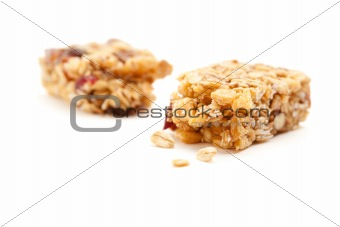 Broken Granola Bar Isolated on a White Background with Narrow Depth of Field.