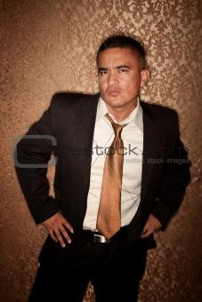 Skeptical Hispanic Man