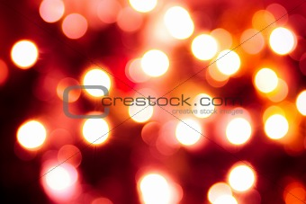 Abstract background of lights. Red tint
