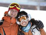 Lucky couple  snowboarders  in a mountain