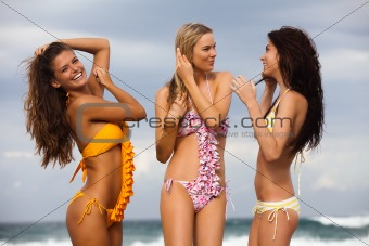 Three Friends in Swimsuits at the Beach