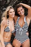Two Smiling Women Wearing Striped Swimsuits