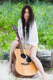 Attractive Young Woman Outdoors With Guitar