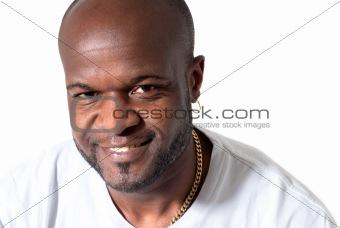 Black men smiling on white background.