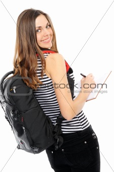 beautiful girl with a backpack, holds the book