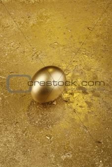 Gold Easter egg on a golden background