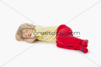 beautiful boy with long blond hair sleeping on the floor