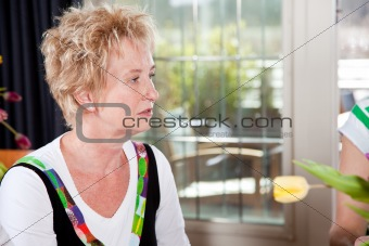 Attractive mature woman in restaurant