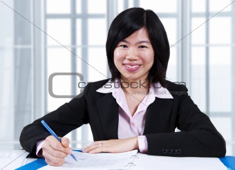 Asian woman working in office