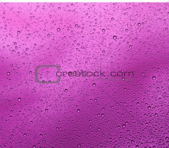 Liquid drops on purple background