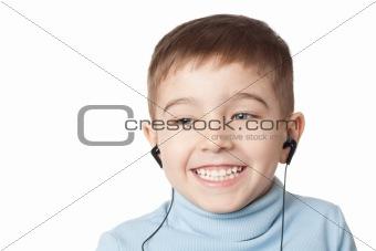 Smiling boy in earphones