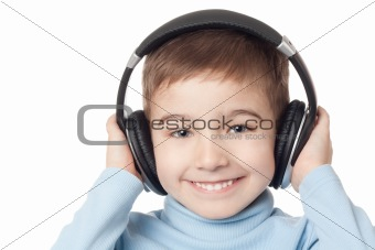 Smiling boy in headphones