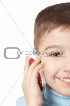Smiling boy with mobilel phone