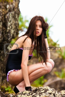 Attractive Young Woman Wearing a Black Swimsuit