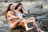 Attractive Young Women Sitting on a Rock