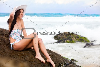 Attractive Young Woman Wearing a Swimsuit and a Hat