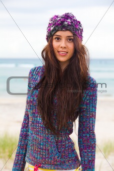 Attractive Young Woman Wearing a Sweater and Knit Cap