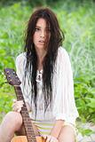 Attractive Young Woman With Guitar