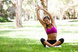 Young Woman Doing Yoga in Park