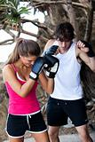 Young Couple Practicing Boxing Outdoors