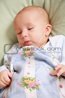 Adorable newborn in bed