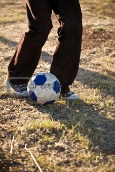 Boy kicking soccer boy