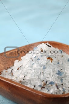 Blue bath salt in a wooden bowl