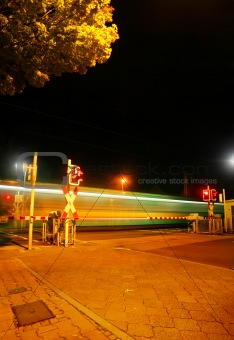 Railroad crossing at night of a Metro