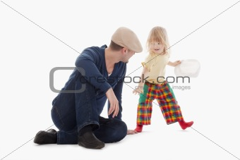 boy with long blond hair having fun with his father - isolated on white