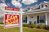 Sold Short Sale Home For Sale Real Estate Sign in Front of New House - Left Facing.