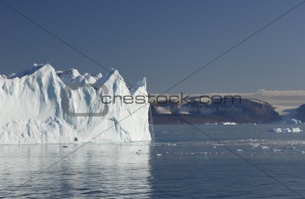 Iceberg with waterfall in Greenland